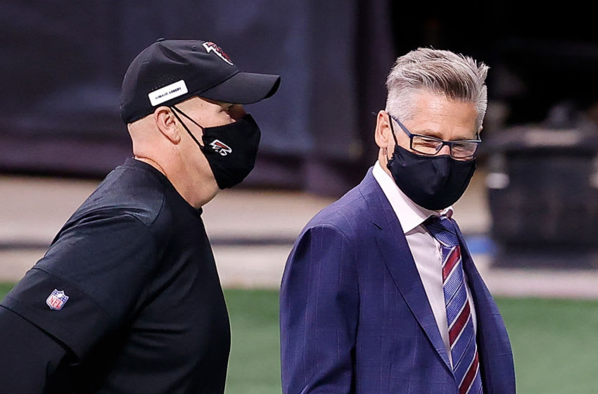 ATLANTA, GEORGIA - OCTOBER 11: Head coach Dan Quinn of the Atlanta Falcons walks off the field with general manager Thomas Dimitroff after their 23-16 loss to the Carolina Panthers at Mercedes-Benz Stadium on October 11, 2020 in Atlanta, Georgia. (Photo by Kevin C. Cox/Getty Images)