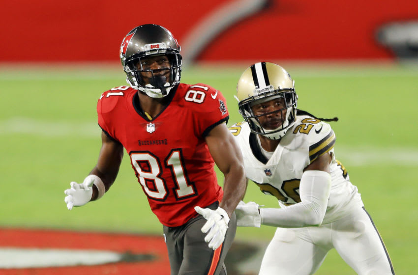 TAMPA, FLORIDA - NOVEMBER 08: Antonio Brown #81 of the Tampa Bay Buccaneers runs a route against Janoris Jenkins #20 of the New Orleans Saints during the first half at Raymond James Stadium on November 08, 2020 in Tampa, Florida. (Photo by Mike Ehrmann/Getty Images)