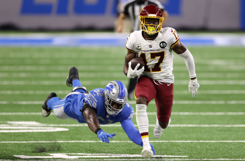 DETROIT, MICHIGAN - NOVEMBER 15: Terry McLaurin #17 of the Washington Football Team attempts to run with the ball against Christian Jones #52 of the Detroit Lions during their game at Ford Field on November 15, 2020 in Detroit, Michigan. (Photo by Gregory Shamus/Getty Images)