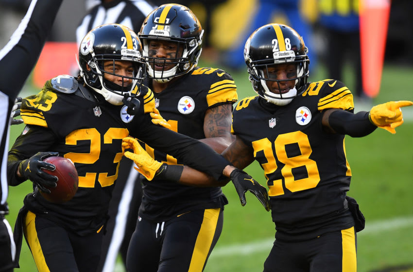 PITTSBURGH, PENNSYLVANIA - DECEMBER 02: From left, Joe Haden #23, Avery Williamson #51 and Mike Hilton #28 of the Pittsburgh Steelers celebrate following a touchdown by Haden during the first quarter against the Baltimore Ravens at Heinz Field on December 02, 2020 in Pittsburgh, Pennsylvania. (Photo by Joe Sargent/Getty Images)