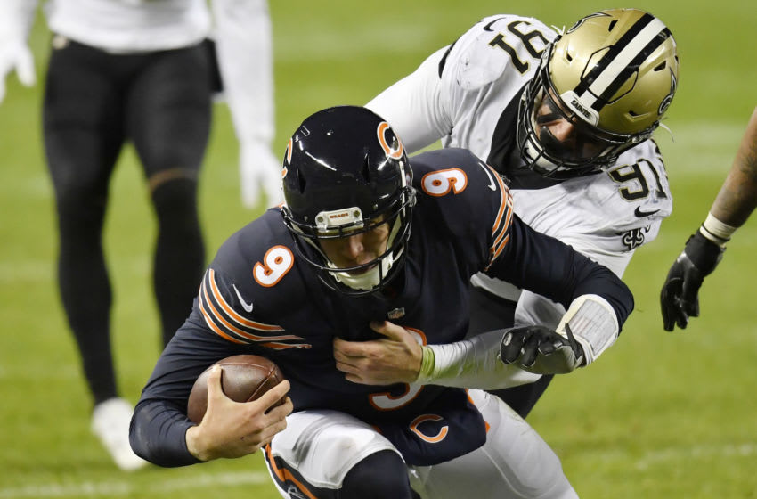 CHICAGO, ILLINOIS - NOVEMBER 01: Nick Foles #9 of the Chicago Bears is tackled by defensive end Trey Hendrickson #91 of the New Orleans Saints at Soldier Field on November 01, 2020 in Chicago, Illinois. (Photo by Quinn Harris/Getty Images)