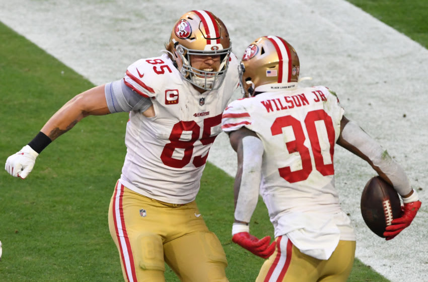 GLENDALE, ARIZONA - DECEMBER 26: Running back Jeff Wilson Jr. #30 celebrates with tight end George Kittle #85 of the San Francisco 49ers after Wilson's touchdown during the first half against the Arizona Cardinals at State Farm Stadium on December 26, 2020 in Glendale, Arizona. (Photo by Norm Hall/Getty Images)
