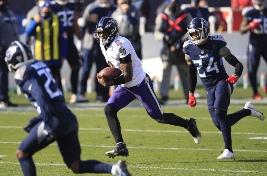 NASHVILLE, TENNESSEE - JANUARY 10: Quarterback Lamar Jackson #8 of the Baltimore Ravens carries the ball in the middle of a 48-yard touchdown run during the second quarter of their AFC Wild Card Playoff game against the Tennessee Titans at Nissan Stadium on January 10, 2021 in Nashville, Tennessee. (Photo by Andy Lyons/Getty Images)