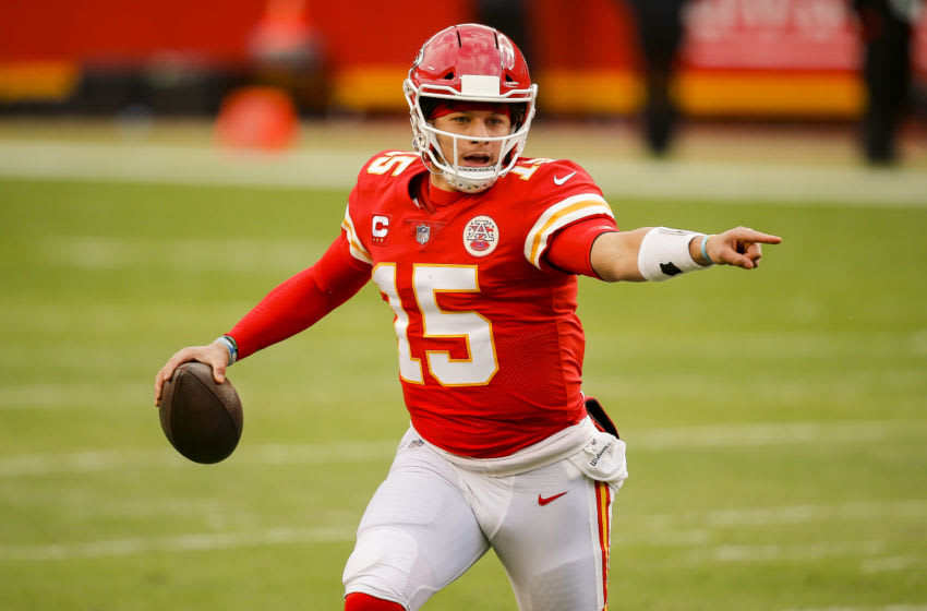 KANSAS CITY, MO - JANUARY 17: Patrick Mahomes #15 of the Kansas City Chiefs looks for an open receiver in the second quarter against the Cleveland Browns in the AFC Divisional Playoff at Arrowhead Stadium on January 17, 2021 in Kansas City, Missouri. (Photo by David Eulitt/Getty Images)