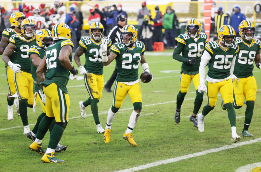 GREEN BAY, WISCONSIN - JANUARY 24: Jaire Alexander #23 of the Green Bay Packers celebrates his interception in the fourth quarter against the Tampa Bay Buccaneers during the NFC Championship game at Lambeau Field on January 24, 2021 in Green Bay, Wisconsin. (Photo by Dylan Buell/Getty Images)