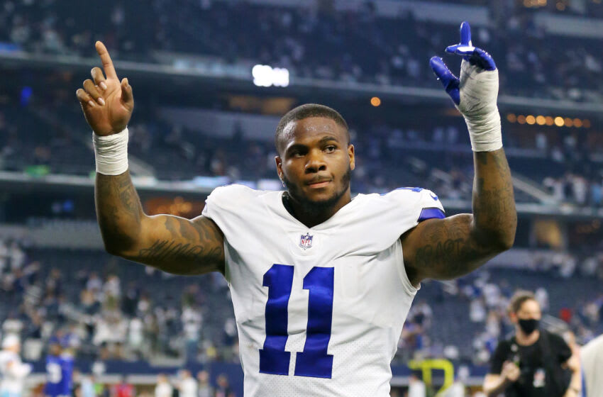 ARLINGTON, TEXAS - OCTOBER 10: Micah Parsons #11 of the Dallas Cowboys celebrates after defeating the New York Giants at AT&T Stadium on October 10, 2021 in Arlington, Texas. (Photo by Richard Rodriguez/Getty Images)