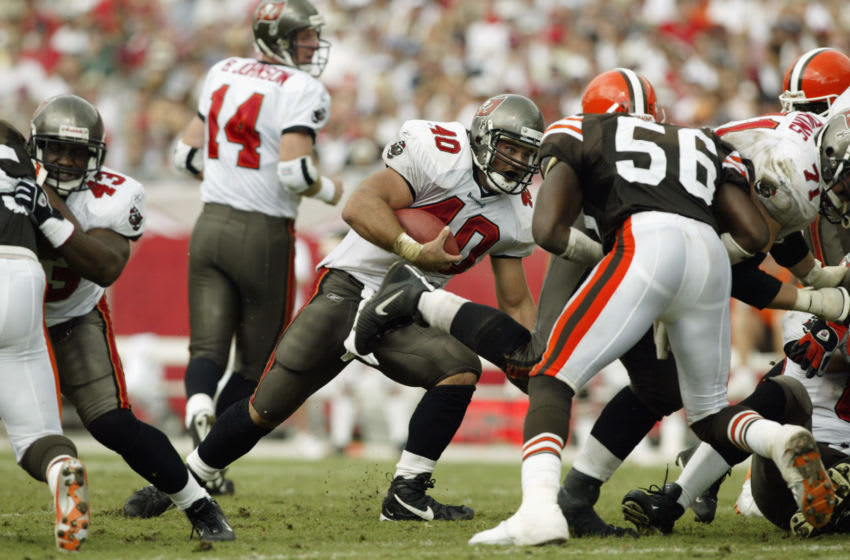 TAMPA, FL - OCTOBER 13: Running back Mike Alstott #40 of the Tampa Bay Buccaneers runs with the ball during the NFL game against the Cleveland Browns on October 13, 2002 at Raymond James Stadium in Tampa, Florida. The Buccaneers won 17-3. (Photo by Andy Lyons/Getty Images)