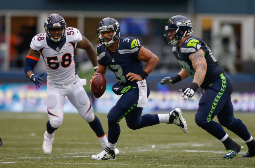 SEATTLE, WA - AUGUST 14: Quarterback Russell Wilson #3 of the Seattle Seahawks rushes against the Denver Broncos at CenturyLink Field on August 14, 2015 in Seattle, Washington. (Photo by Otto Greule Jr/Getty Images)