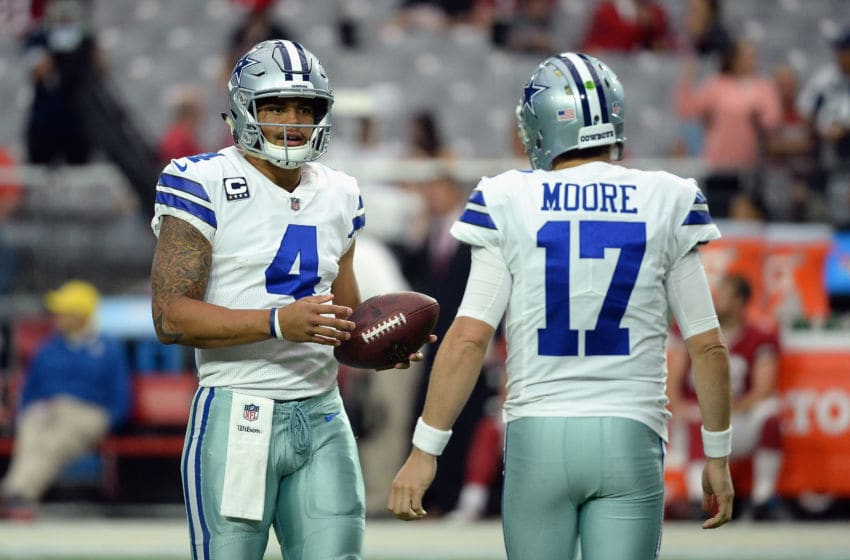 GLENDALE, AZ - SEPTEMBER 25: Quarterback Dak Prescott #4 of the Dallas Cowboys talks with quarterback Kellen Moore #17 before the start of the NFL game against the Arizona Cardinals at the University of Phoenix Stadium on September 25, 2017 in Glendale, Arizona. (Photo by Jennifer Stewart/Getty Images)