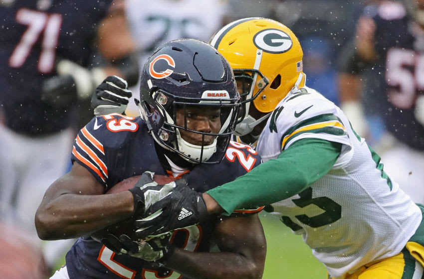 CHICAGO, IL - NOVEMBER 12: Tarik Cohen #29 of the Chicago Bears is hit by Damarious Randall #23 of the Green Bay Packers at Soldier Field on November 12, 2017 in Chicago, Illinois. The Packers defeated the Bears 23-16. (Photo by Jonathan Daniel/Getty Images)