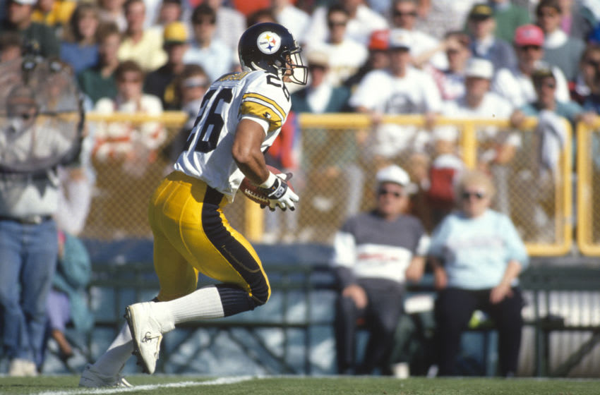 UNSPECIFIED - CIRCA 1992: Rod Woodson #26 of the Pittsburgh Steelers runs with the ball during an NFL football game circa 1992. Woodson played for the Steelers from 1987-96. (Photo by Focus on Sport/Getty Images)