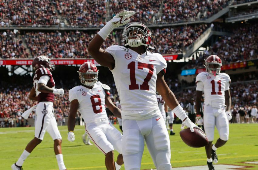 Alabama wide receiver Jaylen Waddle (17) celebrates with teammates after scoring a touchdown against Texas A&M during the first half at Kyle Field Saturday, Oct. 12, 2019 in College Station, Texas. [Staff Photo/Gary Cosby Jr.] Alabama Vs Texas A M