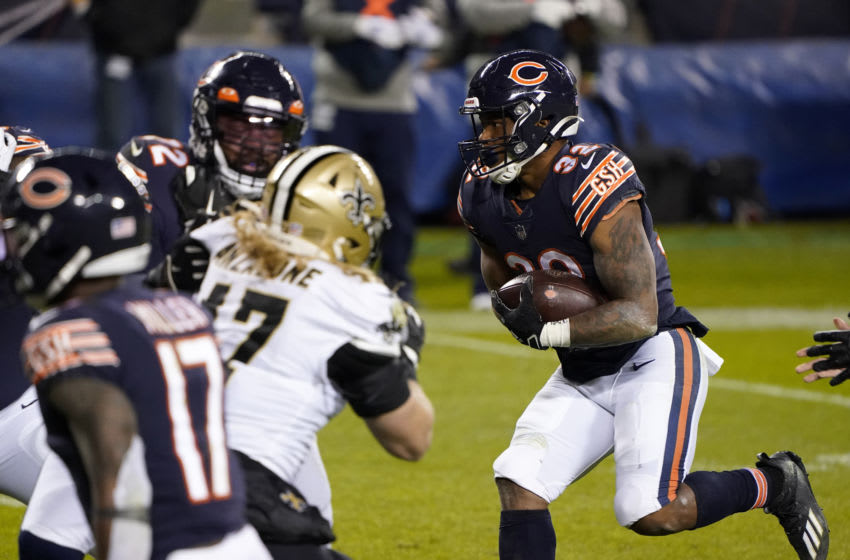 Nov 1, 2020; Chicago, Illinois, USA; Chicago Bears running back David Montgomery (32) rushes the ball against the New Orleans Saints during the fourth quarter at Soldier Field. Mandatory Credit: Mike Dinovo-USA TODAY Sports