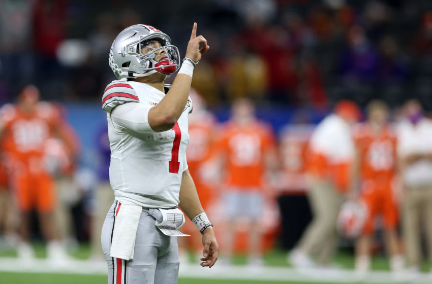 Jan 1, 2021; New Orleans, LA, USA; Ohio State Buckeyes quarterback Justin Fields (1) celebrates after a touchdown pass against the Clemson Tigers during the first half at Mercedes-Benz Superdome. Mandatory Credit: Chuck Cook-USA TODAY Sports