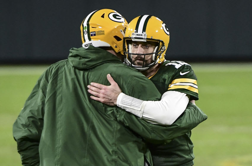 Jan 16, 2021; Green Bay, Wisconsin, USA; Green Bay Packers quarterback Aaron Rodgers (12) celebrates after beating the Los Angeles Rams at Lambeau Field. Mandatory Credit: Benny Sieu-USA TODAY Sports