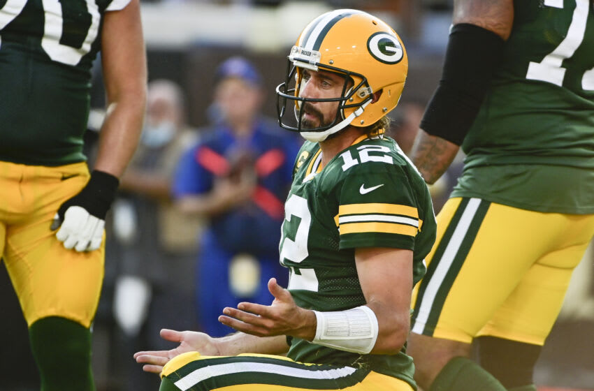 Sep 12, 2021; Jacksonville, Florida, USA; Green Bay Packers quarterback Aaron Rodgers (12) reacts after being sacked in the first half against the New Orleans Saints at TIAA Bank Field. Mandatory Credit: Tommy Gilligan-USA TODAY Sports