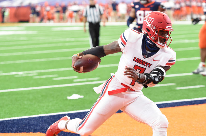Oct 17, 2020; Syracuse, NY, USA; Liberty Flames quarterback Malik Willis (7) scores on a touchdown run in the first half during a game against Syracuse on Saturday, Oct. 17, 2020, at the Carrier Dome in Syracuse, N.Y. Mandatory Credit: Dennis Nett/Pool Photo-USA TODAY Sports