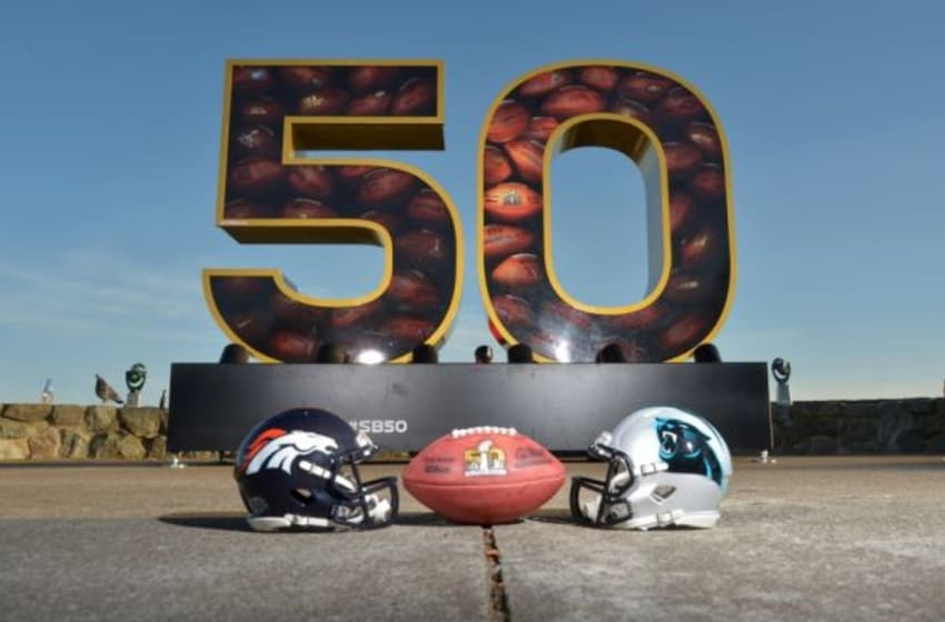 Feb 6, 2016; San Francisco, CA, USA; General view of Carolina Panther and Denver Broncos helmets with NFL Wilson Duke football at Super Bowl 50 sculpture at Twin Peaks. Mandatory Credit: Kirby Lee-USA TODAY Sports