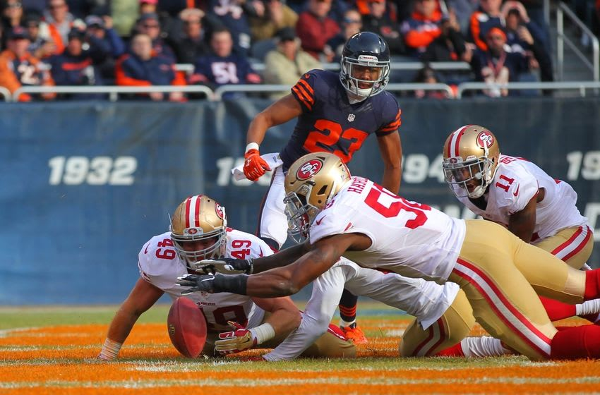 Dec 6, 2015; Chicago, IL, USA; San Francisco 49ers fullback Bruce Miller (49) and outside linebacker Eli Harold (58) try to recover a fumble in the end zone during the first half against the Chicago Bears at Soldier Field. Mandatory Credit: Dennis Wierzbicki-USA TODAY Sports