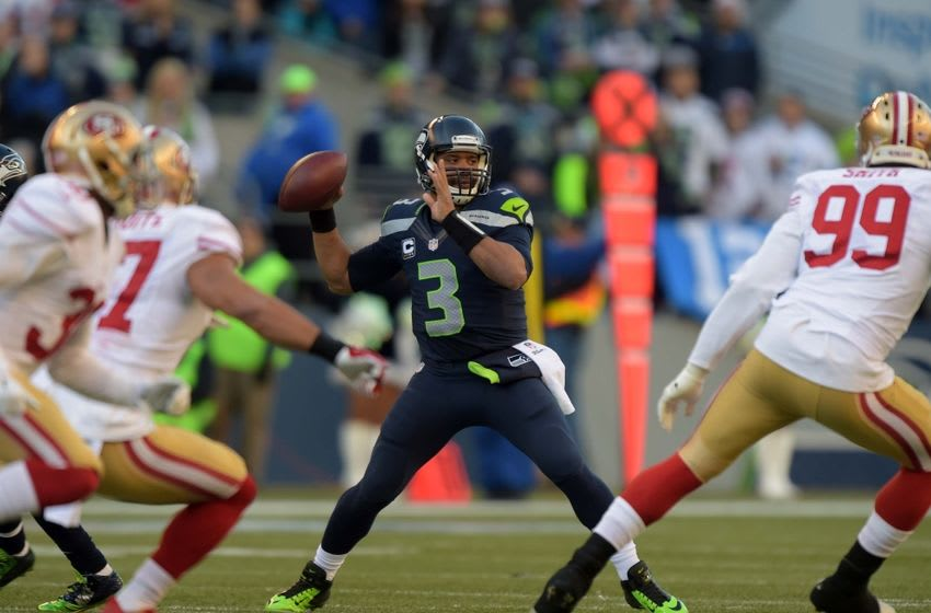 Dec 14, 2014; Seattle, WA, USA; Seattle Seahawks quarterback Russell Wilson (3) throws a pass against the San Francisco 49ers at CenturyLink Field. Mandatory Credit: Kirby Lee-USA TODAY Sports