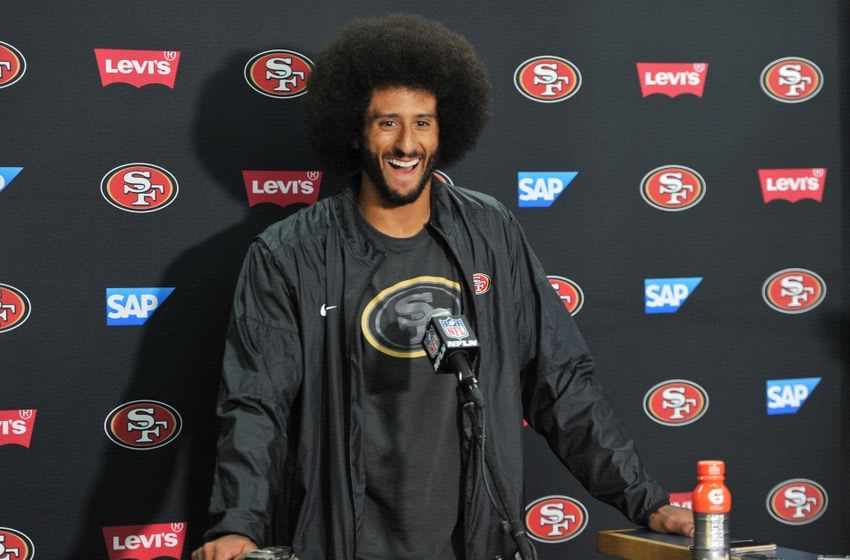 Sep 1, 2016; San Diego, CA, USA; San Francisco 49ers quarterback Colin Kaepernick (7) gestures during a press conference following the game against the San Diego Chargers at Qualcomm Stadium. San Francisco won 31-21. Mandatory Credit: Orlando Ramirez-USA TODAY Sports