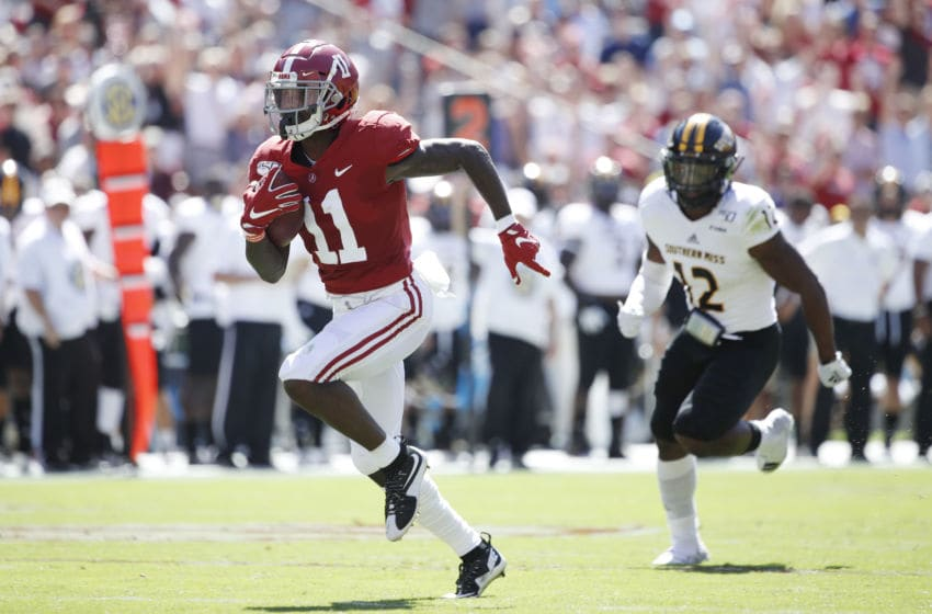 TUSCALOOSA, AL - SEPTEMBER 21: Henry Ruggs III #11 of the Alabama Crimson Tide runs for a 45-yard touchdown in the first quarter after catching a pass behind D.Q. Thomas #12 of the Southern Mississippi Golden Eagles at Bryant-Denny Stadium on September 21, 2019 in Tuscaloosa, Alabama. (Photo by Joe Robbins/Getty Images)