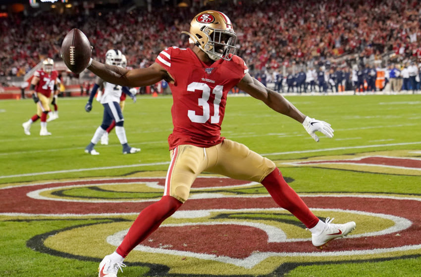 SANTA CLARA, CALIFORNIA - DECEMBER 21: Running back Raheem Mostert #31 of the San Francisco 49ers spikes the ball after a touchdown in the second quarter of the game against the Los Angeles Rams at Levi's Stadium on December 21, 2019 in Santa Clara, California. (Photo by Thearon W. Henderson/Getty Images)