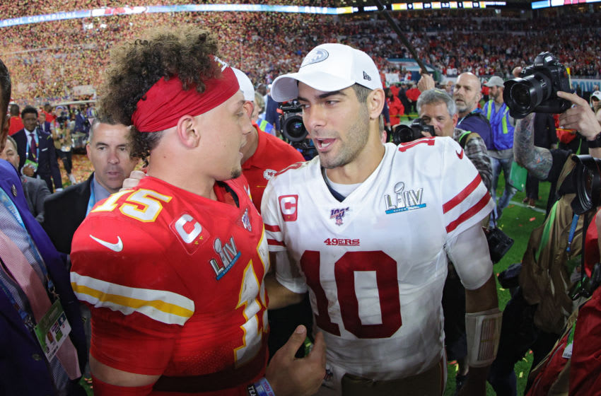Patrick Mahomes #15 of the Kansas City Chiefs with Jimmy Garoppolo #10 of the San Francisco 49ers (Photo by Tom Pennington/Getty Images)