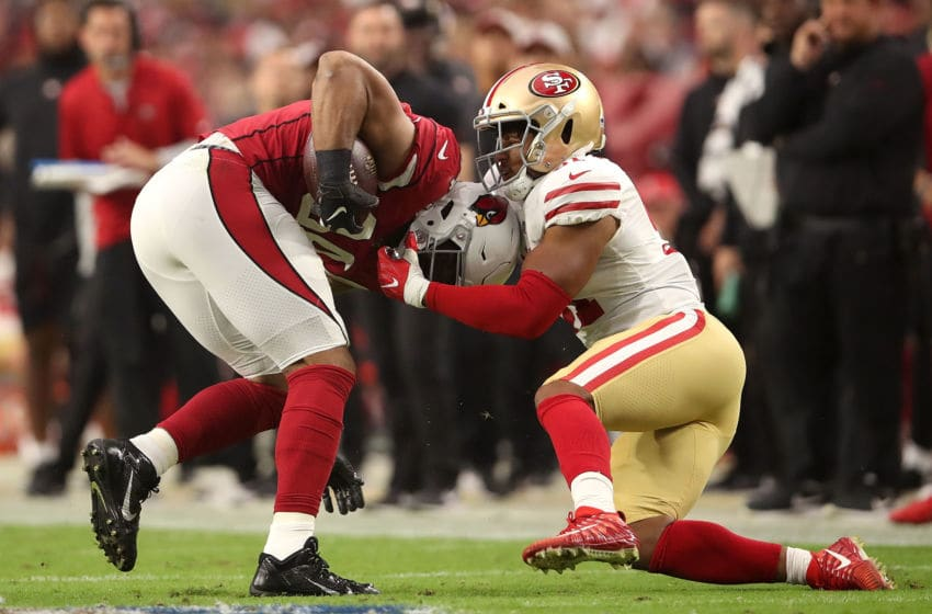 GLENDALE, AZ - OCTOBER 28: Linebacker Malcolm Smith #51 of the San Francisco 49ers tackles tight end Jermaine Gresham #84 of the Arizona Cardinals during the fourth quarter at State Farm Stadium on October 28, 2018 in Glendale, Arizona. (Photo by Christian Petersen/Getty Images)
