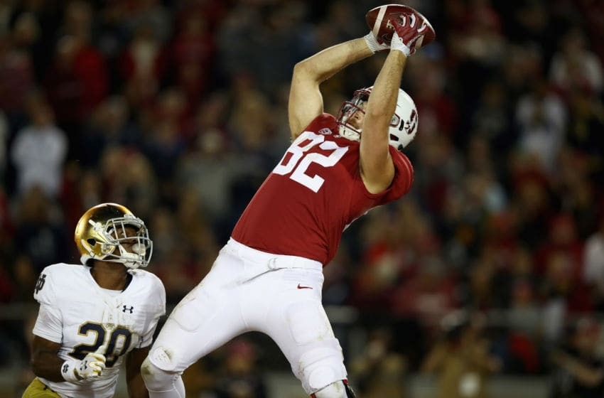 PALO ALTO, CA - NOVEMBER 25: Kaden Smith #82 of the Stanford Cardinal catches a touchdown pass while covered by Shaun Crawford #20 of the Notre Dame Fighting Irish at Stanford Stadium on November 25, 2017 in Palo Alto, California. (Photo by Ezra Shaw/Getty Images)