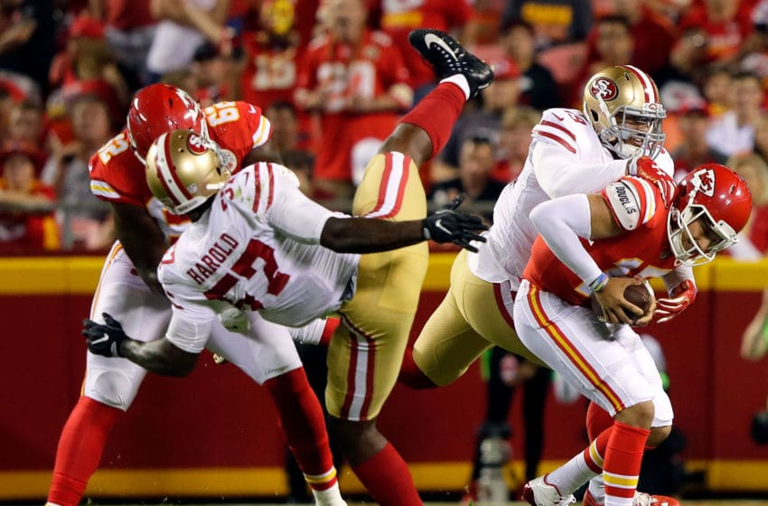 Quarterback Patrick Mahomes #15 of the Kansas City Chiefs is sacked by outside linebacker Aaron Lynch #59 of the San Francisco 49ers (Photo by Jamie Squire/Getty Images)