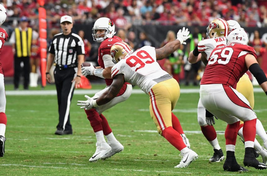 GLENDALE, AZ - OCTOBER 01: Defensive tackle DeForest Buckner #99 of the San Francisco 49ers hits quarterback Carson Palmer #3 of the Arizona Cardinals during the second half of the NFL game at the University of Phoenix Stadium on October 1, 2017 in Glendale, Arizona. (Photo by Norm Hall/Getty Images)