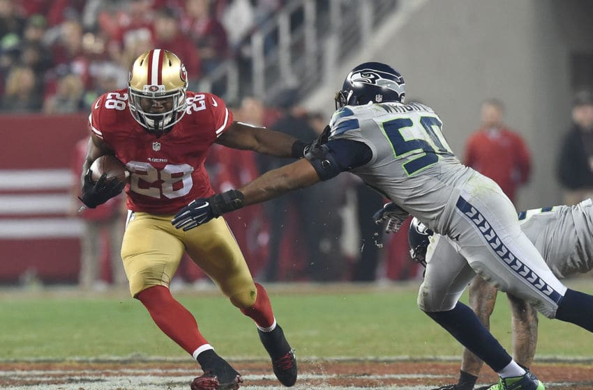 SANTA CLARA, CA - NOVEMBER 27: Carlos Hyde #28 of the San Francisco 49ers breaks the tackle of K.J. Wright #50 of the Seattle Seahawks in the third quarter at Levi's Stadium on November 27, 2014 in Santa Clara, California. (Photo by Thearon W. Henderson/Getty Images)