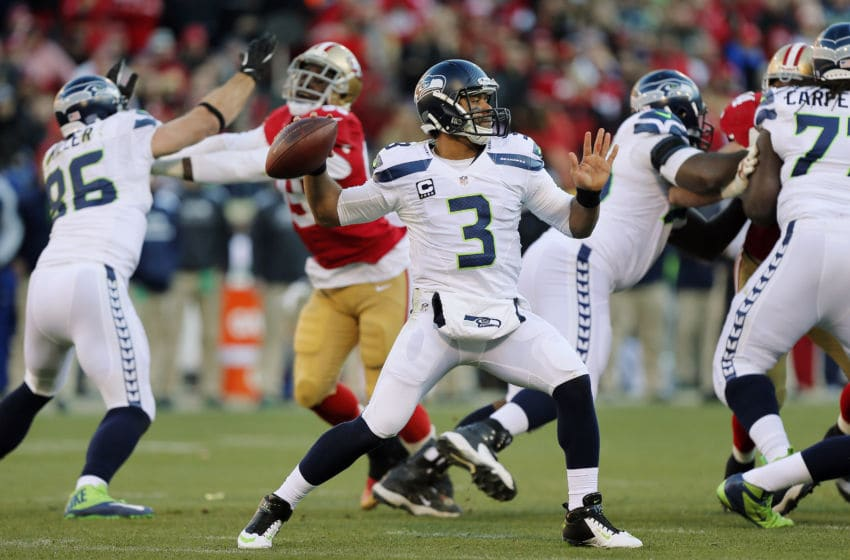 SAN FRANCISCO, CA - DECEMBER 08: Quarterback Russell Wilson #3 of the Seattle Seahawks throws to wide receiver Golden Tate for eight yards against the San Francisco 49ers in the third quarter on December 8, 2013 at Candlestick Park in San Francisco, California. The 49ers won 19-17. (Photo by Brian Bahr/Getty Images)