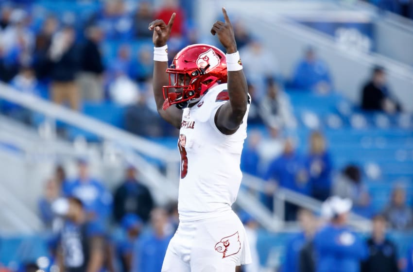 LEXINGTON, KY - NOVEMBER 25: Lamar Jackson #8 of the Louisville Cardinals celebrates a touchdown against the Kentucky Wildcats during the game at Commonwealth Stadium on November 25, 2017 in Lexington, Kentucky. (Photo by Andy Lyons/Getty Images)