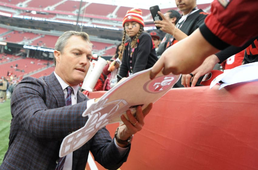 SANTA CLARA, CA - DECEMBER 24: General Manager John Lynch signs autographs for fans prior to their NFL game against the Jacksonville Jaguars at Levi's Stadium on December 24, 2017 in Santa Clara, California. (Photo by Robert Reiners/Getty Images)