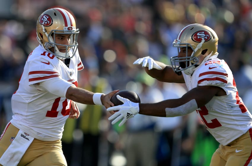 LOS ANGELES, CA - DECEMBER 31: Jimmy Garoppolo #10 hands off to Matt Breida #22 of the San Francisco 49ers during the first half of a game against the Los Angeles Rams at Los Angeles Memorial Coliseum on December 31, 2017 in Los Angeles, California. (Photo by Sean M. Haffey/Getty Images)