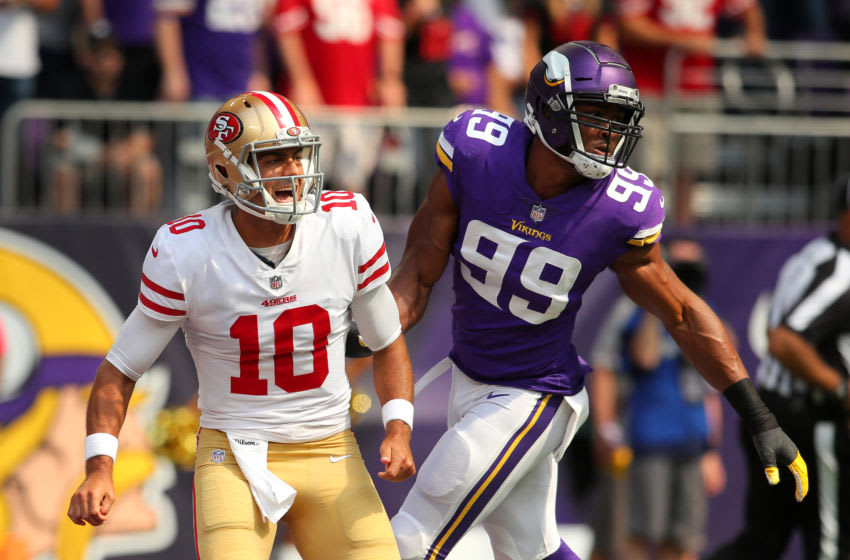 MINNEAPOLIS, MN - SEPTEMBER 09: Jimmy Garoppolo #10 of the San Francisco 49ers reacts after passing the ball in the first half of the game against the Minnesota Vikings at U.S. Bank Stadium on September 9, 2018 in Minneapolis, Minnesota. (Photo by Adam Bettcher/Getty Images)