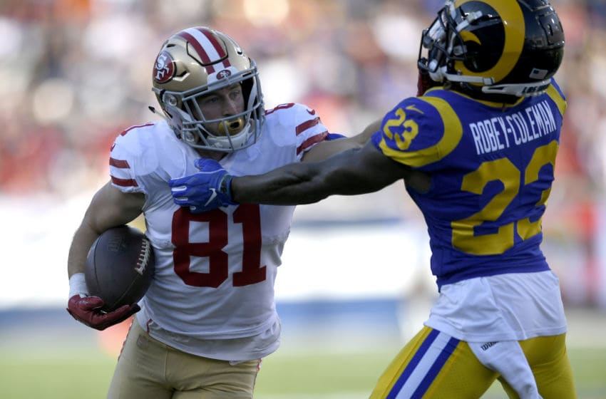 LOS ANGELES, CA - DECEMBER 30: Trent Taylor #81 of the San Francisco 49ers stiff arms Nickell Robey-Coleman #23 of the Los Angeles Rams at Los Angeles Memorial Coliseum on December 30, 2018 in Los Angeles, California. Rams won 48-32. (Photo by John McCoy/Getty Images)