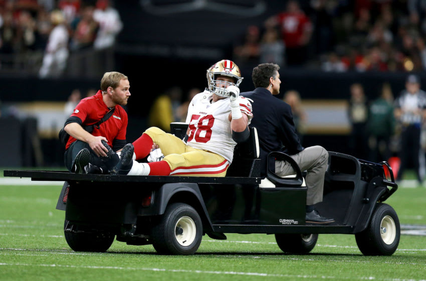 NEW ORLEANS, LOUISIANA - DECEMBER 08: Weston Richburg #58 of the San Francisco 49ers is carted off the field during a NFL game against the New Orleans Saints at the Mercedes Benz Superdome on December 08, 2019 in New Orleans, Louisiana. (Photo by Sean Gardner/Getty Images)