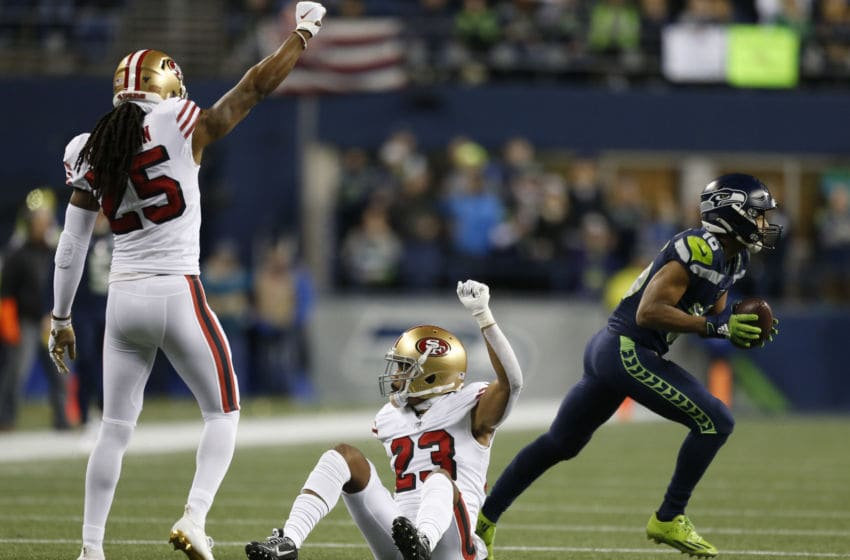 SEATTLE, WASHINGTON - DECEMBER 29: Cornerback Richard Sherman #25 of the San Francisco 49ers and cornerback Ahkello Witherspoon #23 react action wide receiver Tyler Lockett #16 of the Seattle Seahawks during the first half of the game at CenturyLink Field on December 29, 2019 in Seattle, Washington. (Photo by Otto Greule Jr/Getty Images)