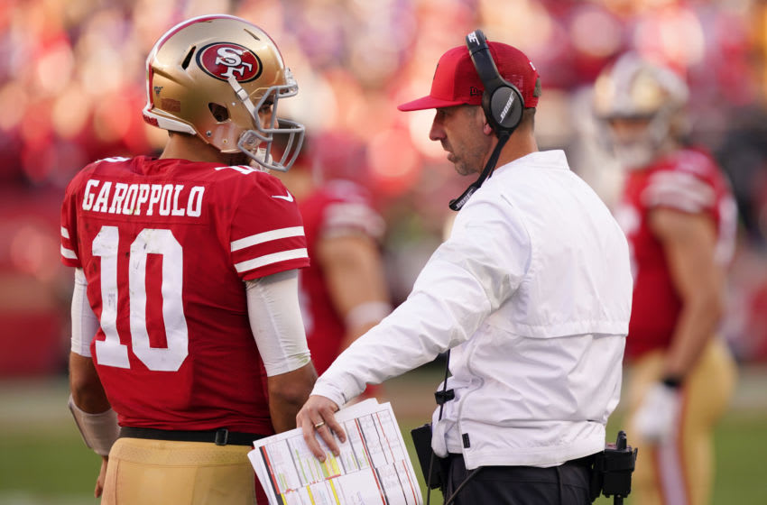 SANTA CLARA, CALIFORNIA - JANUARY 11: Jimmy Garoppolo #10 speaks with head coach Kyle Shanahan of the San Francisco 49ers during the NFC Divisional Round Playoff game against the Minnesota Vikings at Levi's Stadium on January 11, 2020 in Santa Clara, California. (Photo by Thearon W. Henderson/Getty Images)