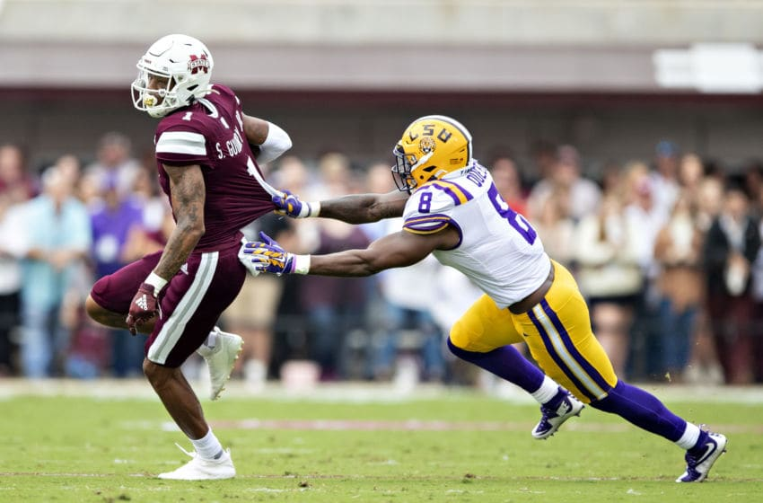 STARKVILLE, MS - OCTOBER 19: Stephen Guidry #1 of the Mississippi State Bulldogs is grabbed from behind by Patrick Queen #8 of the LSU Tigers at Davis Wade Stadium on October 19, 2019 in Starkville, Mississippi. The Tigers defeated the Bulldogs 36-13. (Photo by Wesley Hitt/Getty Images)