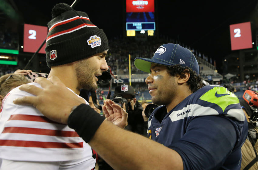 SEATTLE, WASHINGTON - DECEMBER 29: Jimmy Garoppolo #10 of the San Francisco 49ers and Russell Wilson #3 of the Seattle Seahawks hug after the San Francisco 49ers defeated the Seattle Seahawks 26-21 during their game at CenturyLink Field on December 29, 2019 in Seattle, Washington. (Photo by Abbie Parr/Getty Images)