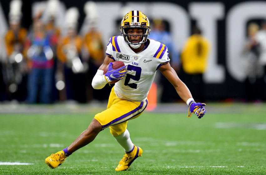 NEW ORLEANS, LOUISIANA - JANUARY 13: Justin Jefferson #2 of the LSU Tigers runs with the ball after a 56-yard pass from Joe Burrow during the second quarter of the College Football Playoff National Championship game against the Clemson Tigers at the Mercedes Benz Superdome on January 13, 2020 in New Orleans, Louisiana. The LSU Tigers topped the Clemson Tigers, 42-25. (Photo by Alika Jenner/Getty Images)