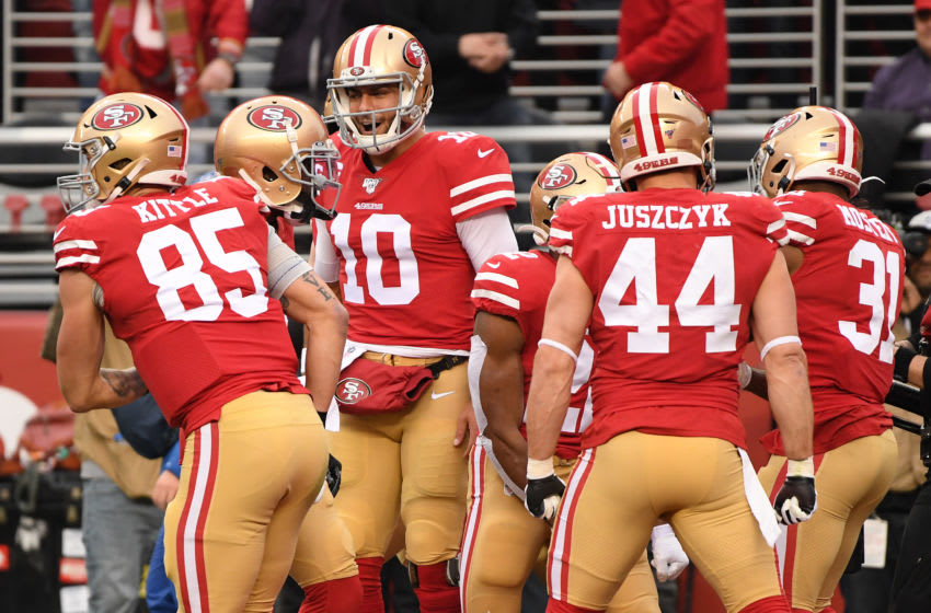 SANTA CLARA, CALIFORNIA - JANUARY 19: Jimmy Garoppolo #10 of the San Francisco 49ers celebrates after a touchdown by Raheem Mostert #31 during the NFC Championship game against the Green Bay Packers at Levi's Stadium on January 19, 2020 in Santa Clara, California. (Photo by Harry How/Getty Images)