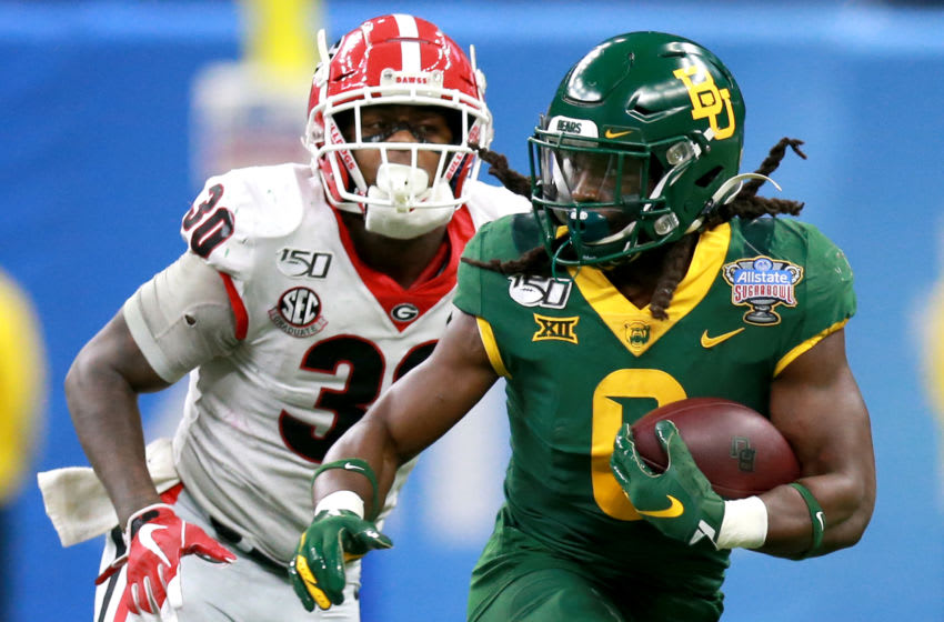NEW ORLEANS, LOUISIANA - JANUARY 01: JaMycal Hasty #6 of the Baylor Bears runs the ball past Tae Crowder #30 of the Georgia Bulldogs during the Allstate Sugar Bowl at Mercedes Benz Superdome on January 01, 2020 in New Orleans, Louisiana. (Photo by Sean Gardner/Getty Images)