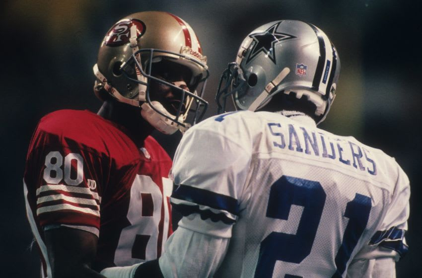 Wide receiver Jerry Rice #80 of the San Francisco 49ers with cornerback Deion Sanders #21 of the Dallas Cowboys (Photo by Joseph Patronite/Getty Images)