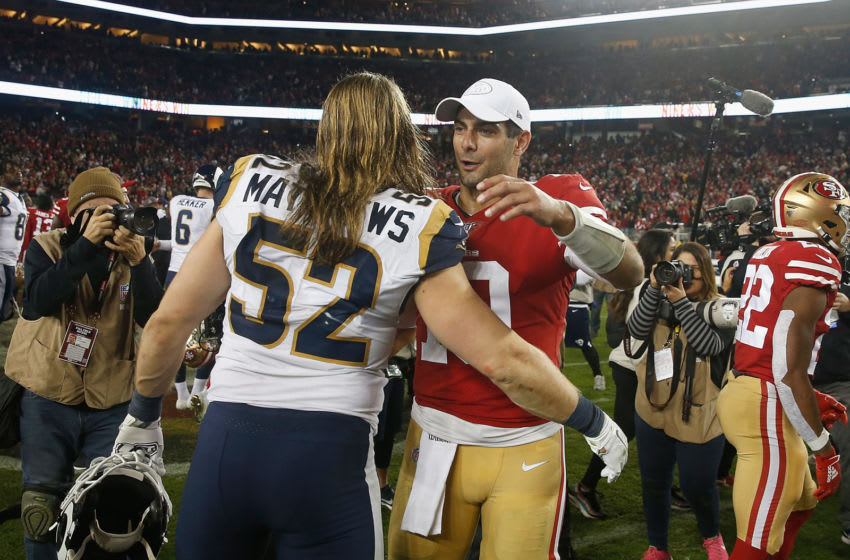 Quarterback Jimmy Garoppolo #10 of the San Francisco 49ers chats to Clay Matthews #52 of the Los Angeles Rams (Photo by Lachlan Cunningham/Getty Images)