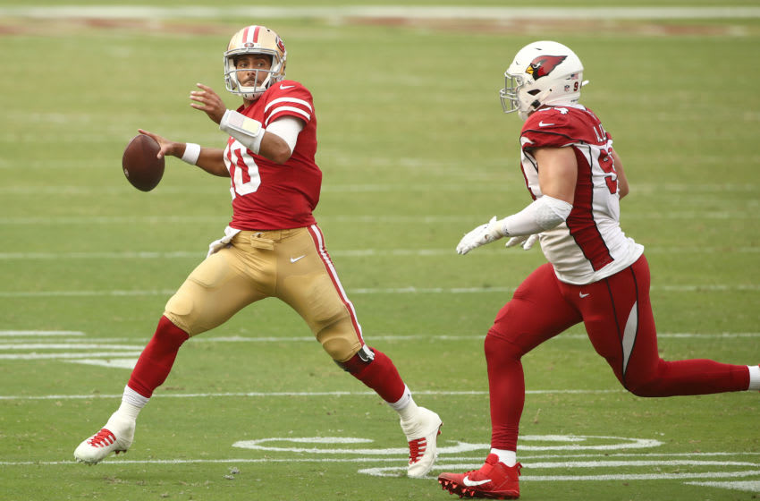 Jimmy Garoppolo #10 of the San Francisco 49ers chased by Zach Allen #94 of the Arizona Cardinals (Photo by Ezra Shaw/Getty Images)